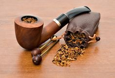 Pipe on a wood. Tobacco-pipe on a wood surface Stock Photo