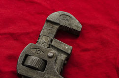 Pipe wrench. As a T-Rex against red background. Pareidolia Royalty Free Stock Image