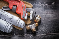 Pipe wrench brass plumbing fittings safety gloves Stock Photography