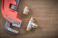 Pipe wrench brass plumbing fixtures on cleaning Stock Photos