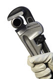 Pipe Wrench II. A gloved hand grips a pipe wrench Stock Photo