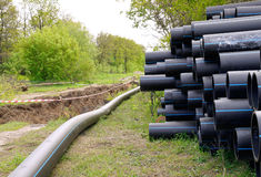 Pipelay. Laying plastic pipes under the ground Stock Photo