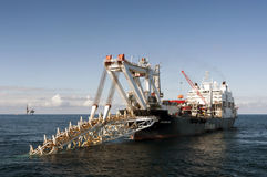 Pipelaying vessel Audacia laying pipes in the North Sea. Royalty Free Stock Images
