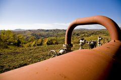 Pipeline. Large commercial pipeline shown in rural countryside setting at a point where it is above ground Stock Photos