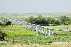Pipeline. A gas pipeline crossing a river valley in the Texas Panhandle Royalty Free Stock Images