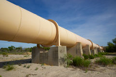 Pipeline above the Mojave Desert. Large metal pipeline stands on girders across the Mojave Desert of California Royalty Free Stock Images