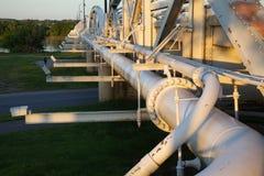 Pipeline alongside a bridge. A highway bridge also carries a pipeline across the Arkansas River near Tulsa, Oklahoma Stock Images