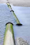 Pipeline on beach, broken connection. Royalty Free Stock Photos