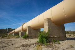 Pipeline through California Desert. Water pipeline supplies the precious resource through the Los Angeles Aqueduct to the city Royalty Free Stock Photography