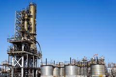 Oil refinery in Russia. equipment and complexes for hydrocarbon processing. Section of technological columns for the manufacture o. Pipeline with a compensator royalty free stock image