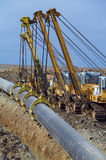 Pipeline construction. Kazakhstan crane construction in night Stock Photos