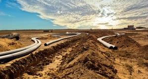 Pipeline construction in Betpakdala. Pipeline construction for technical liquids production Betpakdala Stock Photos