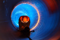 Pipeline construction. A worker works inside a pipe on a pipeline construction Royalty Free Stock Photography