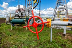 Pipeline with control valve against the background pump jack Royalty Free Stock Images