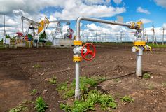 Pipeline with control valve against the background pump jack Stock Photo
