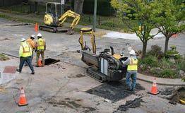 Pipeline Crew Relocating Horizontal Directional Drill Stock Photos