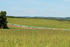 Pipeline and farm Royalty Free Stock Image