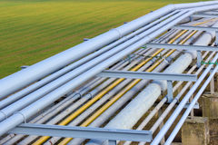 Pipeline on green field Royalty Free Stock Images