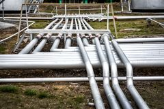 Pipeline group in the oil station Royalty Free Stock Photo