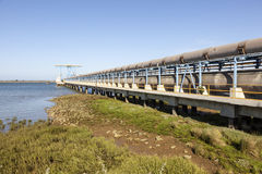 Pipeline in Huelva, Spain. Oil pipeline at the riverbank of Rio Tinto river in Huelva, Spain stock photography