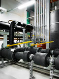 Pipeline in industrial interior Royalty Free Stock Image
