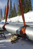 Pipeline installation. Installation of pipes of a thermal network. A pipe in isolation from the zinced steel Stock Image