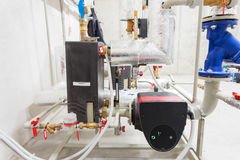Pipeline installation and water pump in boiler room Stock Image