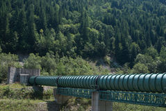 Pipeline in the mountains 2. Pipeline crossing a steep valley in the mountains Royalty Free Stock Photo