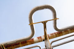 Pipeline. New and old rust pipes in factory stock photos