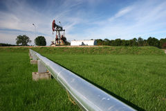 Pipeline and oil pump Stock Photos