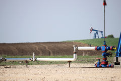 Pipeline and oil pump jack Royalty Free Stock Photos