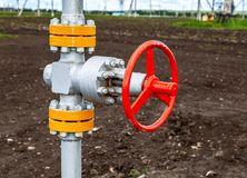 Pipeline with red control valve. Oil industry equipment royalty free stock photos