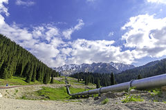 Pipeline on road  Big Almaty Lake, Tien Shan Mountains in Almaty, Kazakhstan Stock Photography