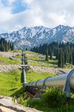 Pipeline on road  Big Almaty Lake, Tien Shan Mountains in Almaty, Kazakhstan Stock Image