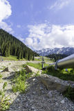 Pipeline on road  Big Almaty Lake, Tien Shan Mountains in Almaty, Kazakhstan Royalty Free Stock Photography