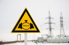 Pipeline sign with transmission tower background. Pipeline sign with hight voltage power transmission tower. Power supply, oil and energetics concept stock images