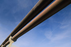 Pipeline in sky. A straight pipeline against blue sky, diagonal composition stock photos