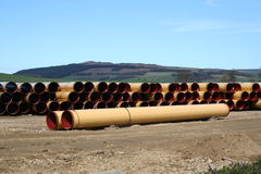 Pipeline Storage Depot. Thousands of pipes in storage ready to be laid royalty free stock image