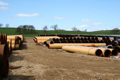 Pipeline Storage Depot. A pipeline storage facility with thousands of steel pipes piled ready for use stock photos