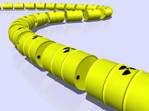 Pipeline or train made from nuclear barrels Royalty Free Stock Photo