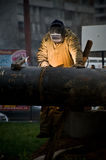 Pipeline welder. Doing his job Stock Photo