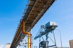Pipelines bridge and giant crane in the jetty pier Stock Photography