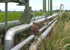Pipelines through a field Stock Images