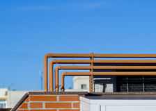 Pipelines on home roof Royalty Free Stock Images