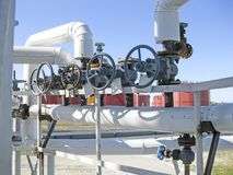 pipelines and latches. Oil refinery. Equipment for primary oil r Stock Image