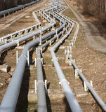 Pipelines leading into the horizon Royalty Free Stock Photos