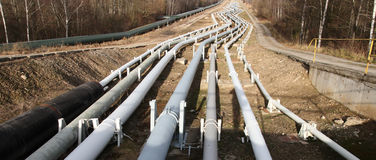 Pipelines leading into the horizon Royalty Free Stock Images