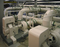 Pipelines and pumps of a water cleaning facility Royalty Free Stock Photo