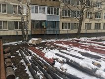 Pipelines in the snow. ST. PETERSBURG, RUSSIA - APRIL 16, 2017 - Pipeline in the snow. Renovation work of the pipeline system as cold and winter continues Royalty Free Stock Image