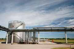 Pipelines and storage tank Royalty Free Stock Images